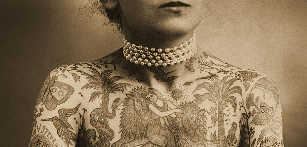 Portrait of a tattooed woman, c.1905 (Sepia Photo)