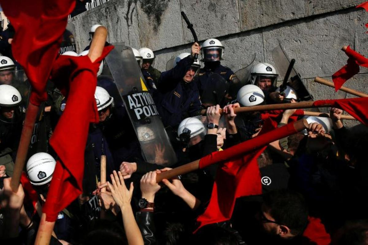 Protesters clash with riot police during a demonstration against planned government reforms in Athens